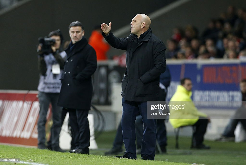 Coach of Lille Frederic Antonetti and coach of Saint-Etienne Christophe Galtier (left) react during the French Ligue 1 match between Lille OSC (LOSC) and AS Saint-Etienne (ASSE) at Stade Pierre Mauroy on December 2, 2015 in Lille, France.
