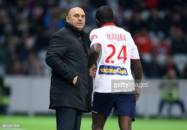 Coach of Lille Frederic Antonetti greets his captain Rio Mavuba when he's replaced during the French Ligue 1 match between Lille OSC and Olympique...