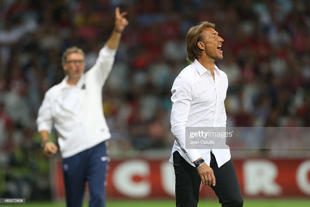 Coach of Lille Herve Renard (right) and coach of PSG Laurent Blanc react during the French Ligue 1 match between Lille OSC (LOSC) and Paris Saint-Germain (PSG) at Grand Stade Pierre Mauroy on August 7, 2015 in Lille, France.