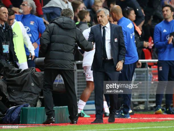 Coach of Lyon Bruno Genesio greets coach of Stade Rennais Christian Gourcuff following the French Ligue 1 match between Stade Rennais and Olympique...