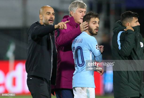 Coach of Manchester City Pep Guardiola Bernardo Silva greet the supporters following the UEFA Champions League match between Feyenoord Rotterdam and...