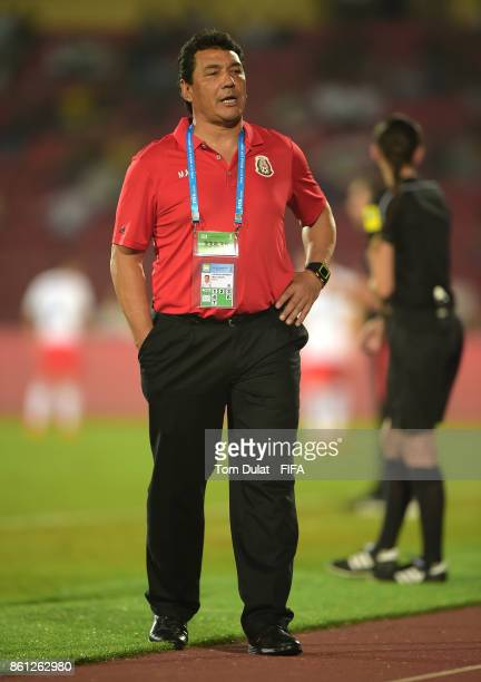 Coach of Mexico Mario Arteaga looks on during the FIFA U17 World Cup India 2017 group E match between Mexico and Chile at Indira Gandhi Athletic...