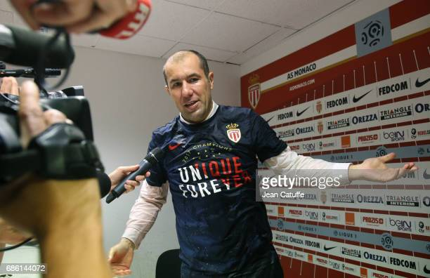 Coach of Monaco Leonardo Jardim after being showered with champagne but his players during his press conference following the French Ligue 1 match...
