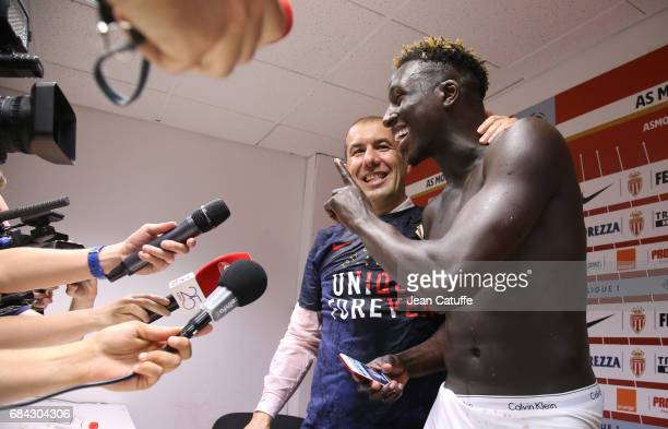 Coach of Monaco Leonardo Jardim is surprised and showered by Benjamin Mendy and teammates during his press conference after winning the French League...