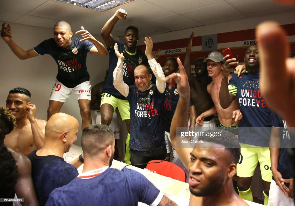 Coach of Monaco Leonardo Jardim is surprised and showered with champagne by his players (Kylian Mbappe top left) during his press conference after winning the French League 1 championship title following AS Monaco and AS Saint-Etienne (ASSE) at Stade Louis II on May 17, 2017 in Monaco, Monaco.