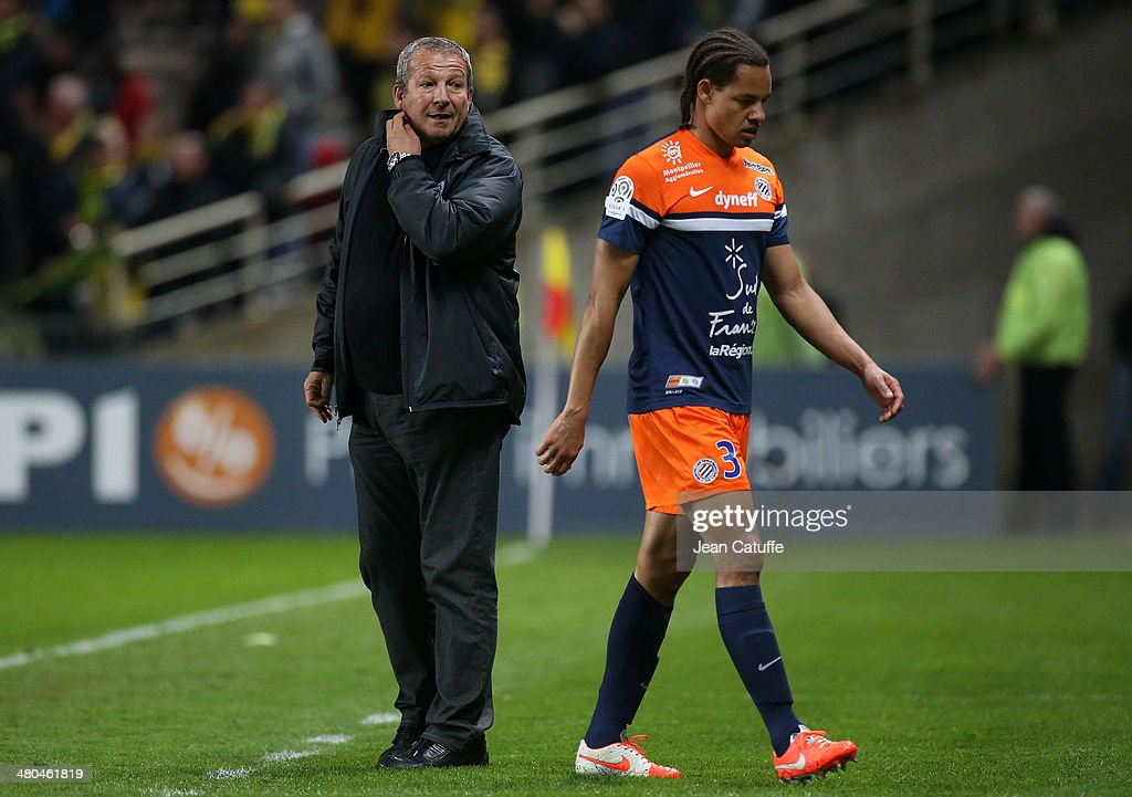 Coach of Montpellier Rolland Courbis looks at <a gi-track='captionPersonalityLinkClicked' href=/galleries/search?phrase=Daniel+Congre&family=editorial&specificpeople=2167788 ng-click='$event.stopPropagation()'>Daniel Congre</a> of Montpellier who leaves the field after receiving a red card during the french Ligue 1 match between FC Nantes and Montpellier Herault SC at Stade de la Beaujoire on March 22, 2014 in Nantes, France.