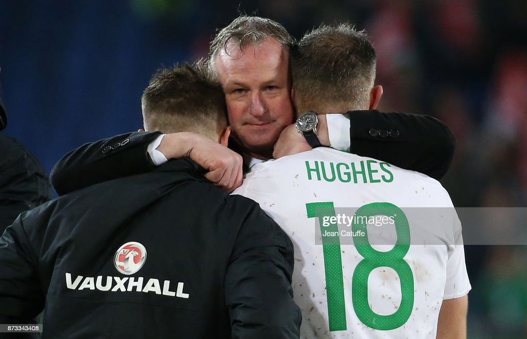 Coach of Northern Ireland Michael O'Neill consoles Oliver Norwood and Aaron Hughes following the FIFA 2018 World Cup Qualifier Play-Off: Second Leg between Switzerland and Northern Ireland at St. Jakob-Park stadium on November 12, 2017 in Basel, Basel-Stadt, Switzerland.