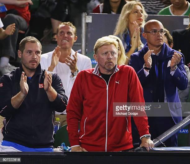 Coach of Novak Djokovic of Serbia Boris Becker looks on as Djokovic breaks serve in his semi final match against Roger Federer of Switzerland during...