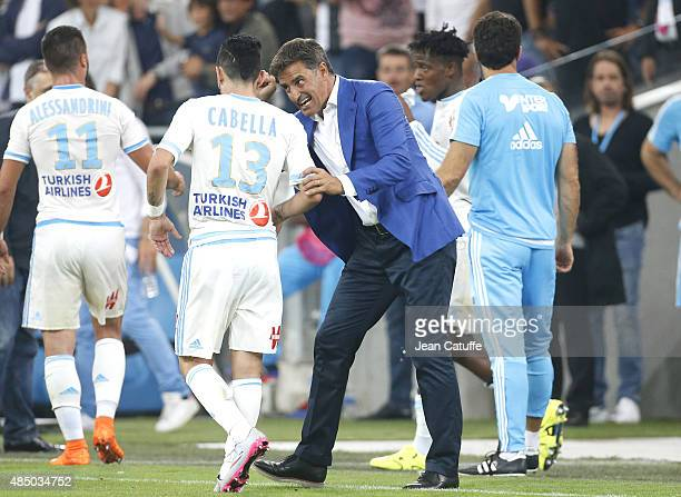 Coach of OM Jose Miguel Gonzalez Martin del Campo aka Michel congratulates Remy Cabella of OM during the French Ligue 1 match between Olympique de...