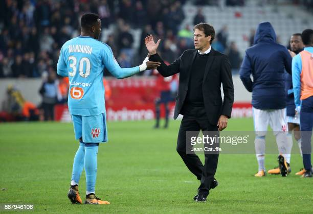 Coach of OM Rudi Garcia greets goalkeeper of OM Steve Mandanda following the French Ligue 1 match between Lille OSC and Olympique de Marseille at...