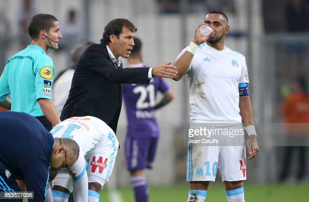 Coach of OM Rudi Garcia talks to Dimitri Payet during the French Ligue 1 match between Olympique de Marseille and Toulouse FC at Stade Velodrome on...