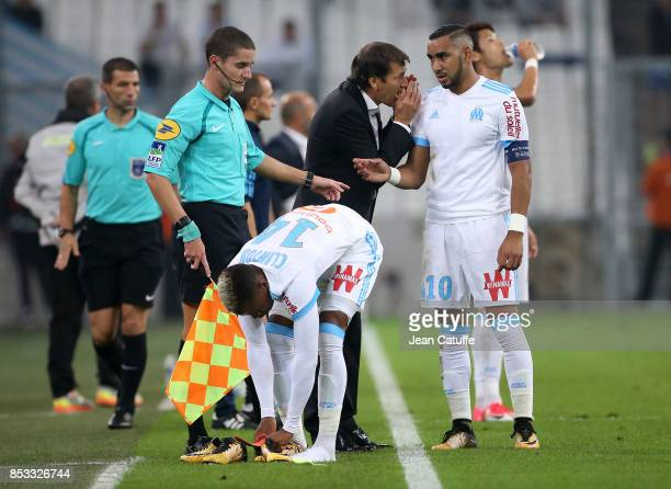 Coach of OM Rudi Garcia talks to Dimitri Payet while Clinton Njie changes his shoes during the French Ligue 1 match between Olympique de Marseille...