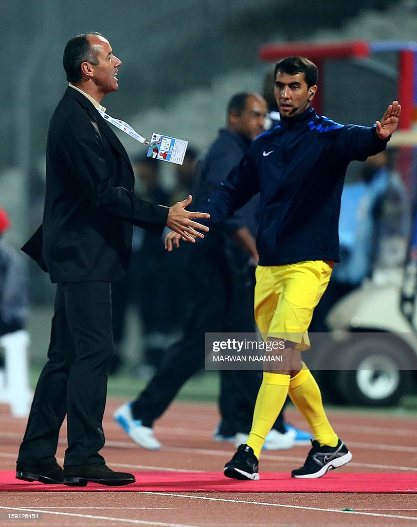 Coach of Oman Paul Joseph Le Guen (L) reacts after the referee gave Qatar a penalty shot against his team during their 21st Gulf Cup football match in Manama, on January 8, 2013.