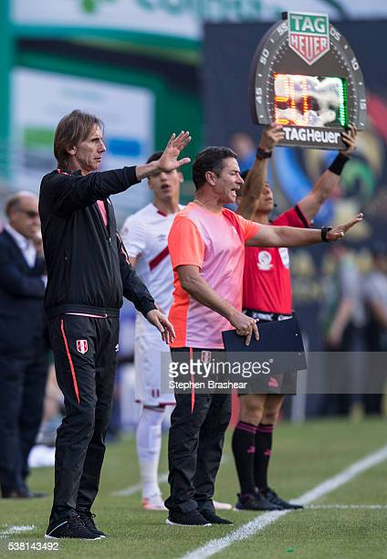 Coach of Peru Ricardo Gareca far left signals to his team during a group B match between Haiti and Peru at CenturyLink Field as part of Copa America...