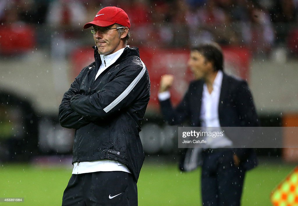 Coach of PSG <a gi-track='captionPersonalityLinkClicked' href=/galleries/search?phrase=Laurent+Blanc&family=editorial&specificpeople=211209 ng-click='$event.stopPropagation()'>Laurent Blanc</a> and coach of Stade de Reims Jean-Luc Vasseur (behind him) react during the French Ligue 1 match between Stade de Reims and Paris Saint Germain FC at the Stade Auguste Delaune on August 8, 2014 in Reims, France.