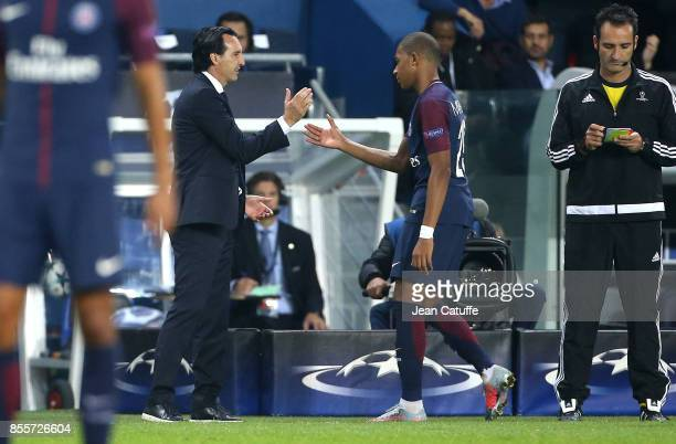 Coach of PSG Unai Emery greets Kylian Mbappe when he's replaced during the UEFA Champions League group B match between Paris SaintGermain and Bayern...