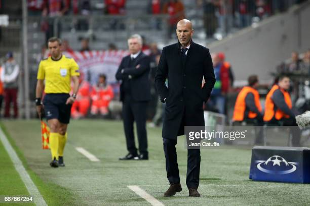 Coach of Real Madrid Zinedine Zidane coach of Bayern Munich Carlo Ancelotti during the UEFA Champions League Quarter Final first leg match between FC...