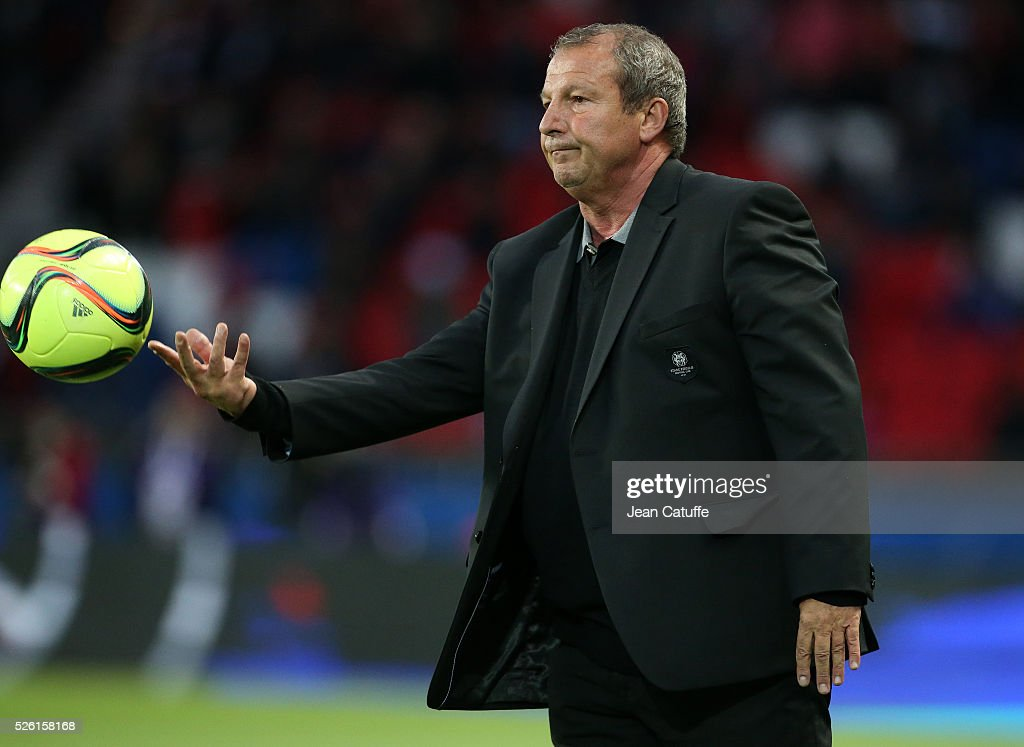 Coach of Rennes <a gi-track='captionPersonalityLinkClicked' href=/galleries/search?phrase=Rolland+Courbis&family=editorial&specificpeople=577313 ng-click='$event.stopPropagation()'>Rolland Courbis</a> throws back the ball during the French Ligue 1 match between Paris Saint-Germain (PSG) and Stade Rennais FC at Parc des Princes stadium on April 29, 2016 in Paris, France.