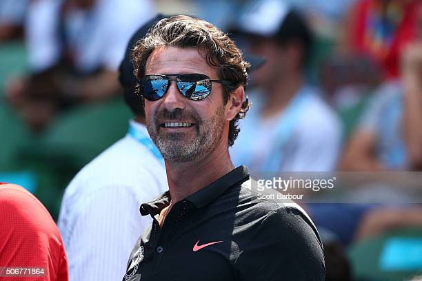 Coach of Serena Williams of the United States Patrick Mouratoglou watches her quarter final match against Maria Sharapova of Russia during day nine...