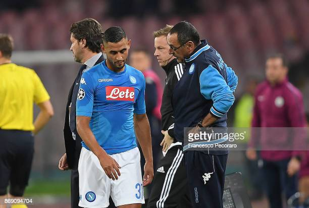 Coach of SSC Napoli Maurizio Sarri and injured player Faouzi Ghoulam during the UEFA Champions League group F match between SSC Napoli and Manchester...