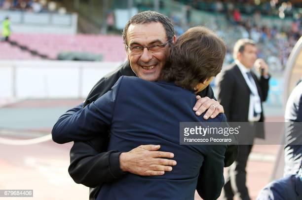 Coach of SSC Napoli Maurizio Sarri greets coach of Cagliari Calcio Massimo Rastelli during the Serie A match between SSC Napoli and Cagliari Calcio...