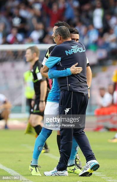 Coach of SSC Napoli Maurizio Sarri greets Jose Calleon after his substitution during the Serie A match between SSC Napoli and Benevento Calcio at...