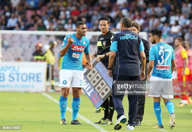Coach of SSC Napoli Maurizio Sarri talks to Faouzi Ghoulam during the Serie A match between SSC Napoli and Benevento Calcio at Stadio San Paolo on...