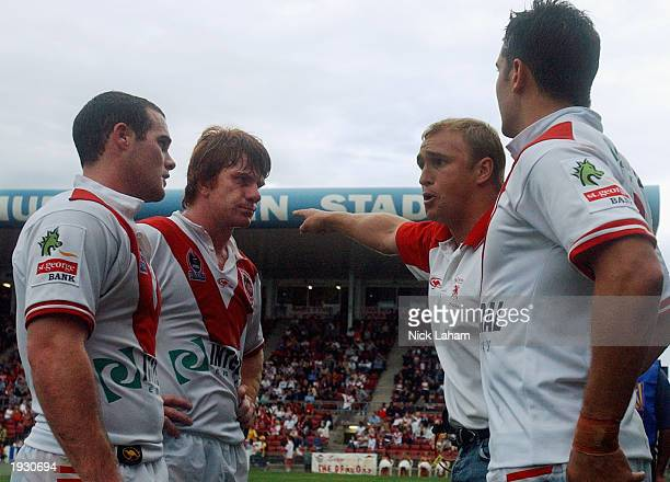 Coach of the Dragons Nathan Brown yells at his players Brett Firman Lance Thompson and Trent Barrett on the sideline during the round five NRL match...