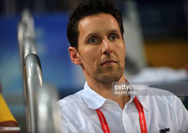 Coach of the German swimming team Henning Lambertz looks at his team on December 14 2012 during the FINA World Short Course Swimming Championships in...