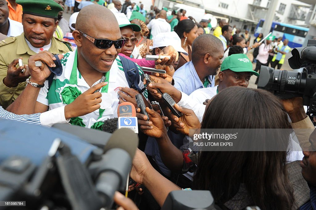 Coach of the Nigerian football team Stephen Keshi speaks to journalists at the airport in Abuja on February 12, 2013. The newly crowned African champions Nigerian Super Eagles arrives in Abuja to a warm reception by fans and government officials after defeating Burkina Faso to win the 2013 African Cup of Nations in South Africa.