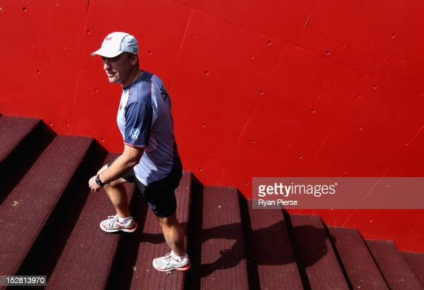 Coach of the Swans John Longmire walks out onto the field during a Sydney Swans AFL training session at Sydney Cricket Ground on September 27 2012 in...