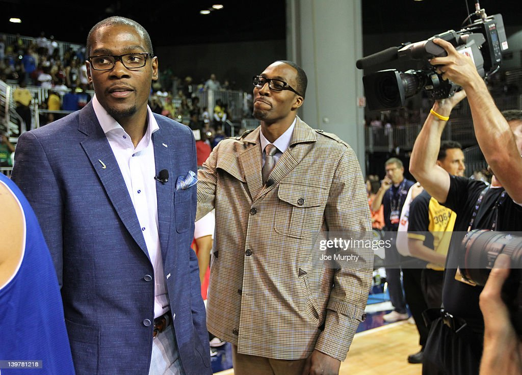 Coach of the West team Kevin Durant of the Oklahoma City Thunder and Coach of the East team Dwight Howard of the Orlando Magic talk during the Sprint All-Star Celebrity Game on center court at Jam Session during the NBA All-Star Weekend on February 24, 2012 at the Orange County Convention Center in Orlando, Florida.