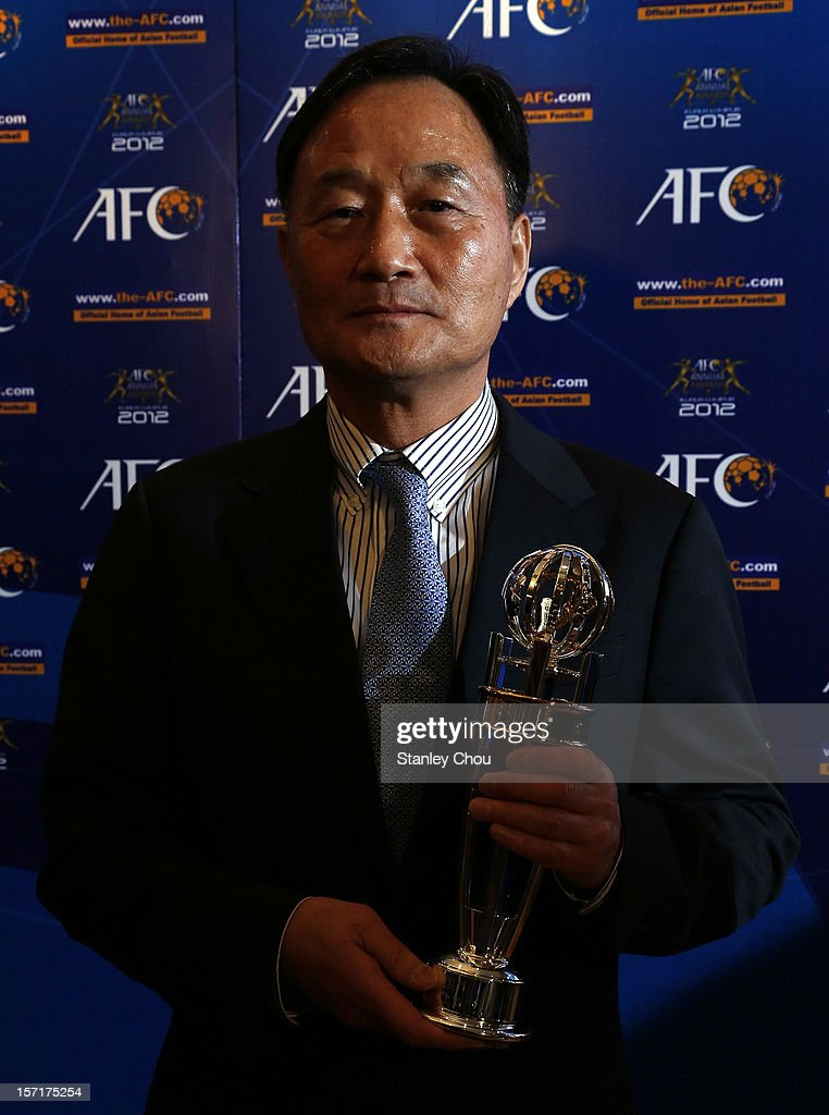 AFC Coach of the Year (Men) Kim Ho-kon poses with the Award during the 2012 AFC Annual Awards at the Mandarin Oriental Hotel on November 29, 2012 in Kuala Lumpur, Malaysia.