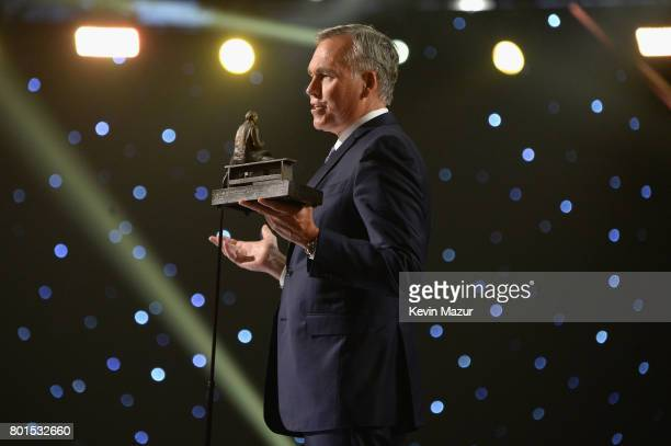 Coach of the Year Mike D'Antoni of the Houston Rockets speaks onstage during the 2017 NBA Awards Live on TNT on June 26 2017 in New York New York...