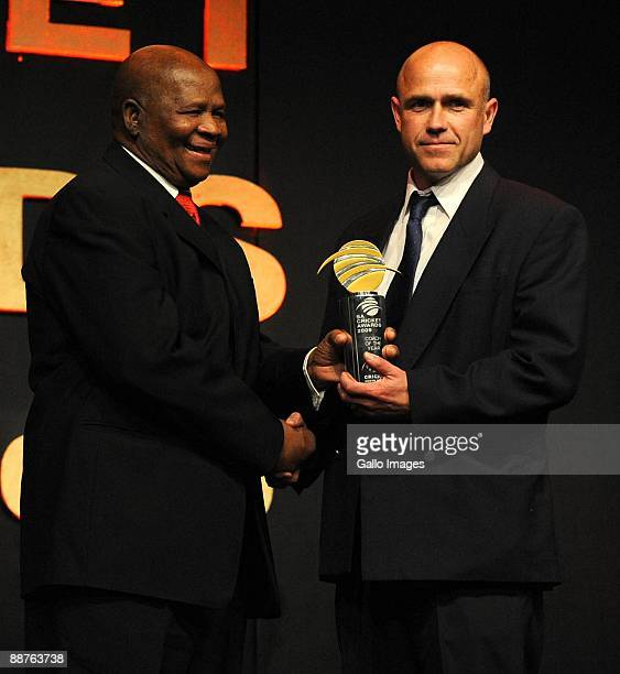 AFRICA JUNE 30 Coach of the Year Richard Pybus receives the award from Ray Mali during the 2009 SA Cricket Awards at the Sandton Convention Centre on...
