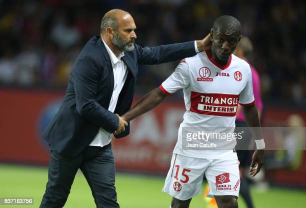 Coach of Toulouse Pascal Dupraz greets MaxAlain Gradel of Toulouse when he's replaced during the French Ligue 1 match between Paris Saint Germain and...