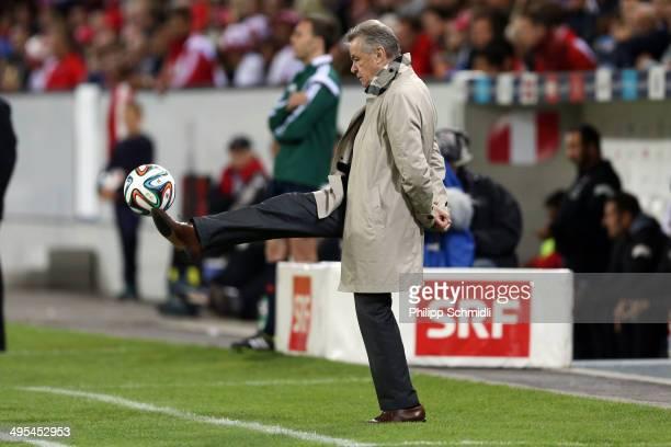 Coach Ottmar Hitzfeld of Switzerland controls the ball during the international friendly match between Switzerland and Peru at Swissporarena on June...