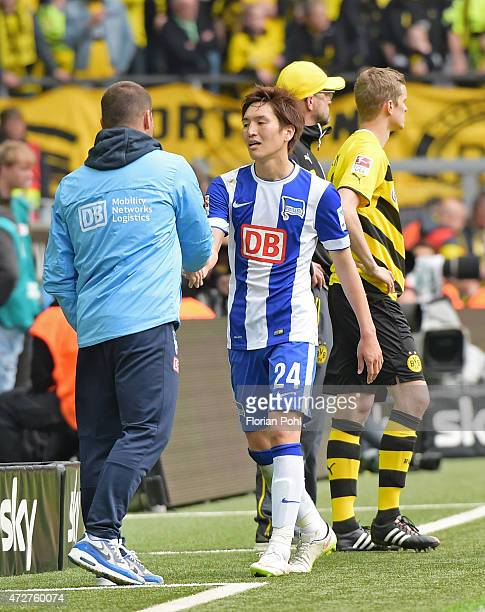 coach Pal Dardai and Genki Haraguchi of Hertha BSC klatschen sich ab during the game between Borussia Dortmund and Hertha BSC on May 9 2015 in...