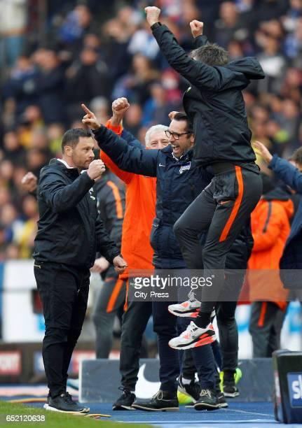 coach Pal Dardai CEO Michael Preetz and assistant coach Rainer Widmayer of Hertha BSC celebrate the 21 win after the Bundesliga match between Hertha...