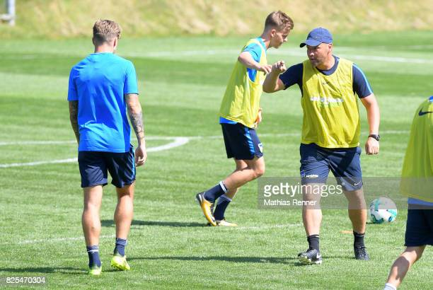 coach Pal Dardai gives instructions next to Alexander Esswein of Hertha BSC during the training camp on august 2 2017 in Schladming Austria