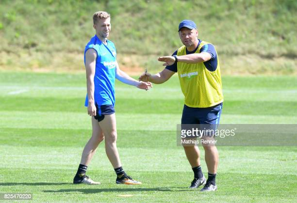 coach Pal Dardai gives instructions next to Mitchell Weiser of Hertha BSC during the training camp on august 2 2017 in Schladming Austria