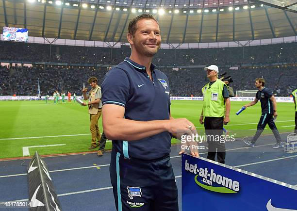 coach Pal Dardai of Hertha BSC smiles during the game between Hertha BSC and Werder Bremen on August 21 2015 in Berlin Germany