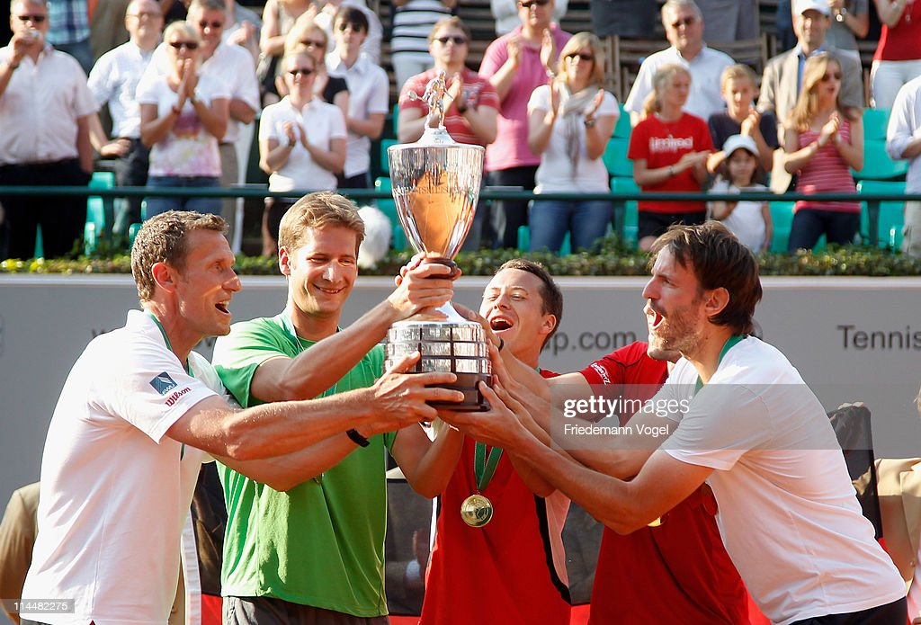 Coach Patrik Kuehnen, <a gi-track='captionPersonalityLinkClicked' href=/galleries/search?phrase=Florian+Mayer&family=editorial&specificpeople=206516 ng-click='$event.stopPropagation()'>Florian Mayer</a>, <a gi-track='captionPersonalityLinkClicked' href=/galleries/search?phrase=Philipp+Kohlschreiber&family=editorial&specificpeople=225202 ng-click='$event.stopPropagation()'>Philipp Kohlschreiber</a>, <a gi-track='captionPersonalityLinkClicked' href=/galleries/search?phrase=Philipp+Petzschner&family=editorial&specificpeople=2464261 ng-click='$event.stopPropagation()'>Philipp Petzschner</a> and <a gi-track='captionPersonalityLinkClicked' href=/galleries/search?phrase=Christopher+Kas&family=editorial&specificpeople=987913 ng-click='$event.stopPropagation()'>Christopher Kas</a> celebrate after winning the Power Horse World Team Cup at the Rochusclub on May 21, 2011 in Duesseldorf, Germany.