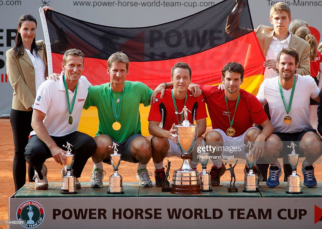 Coach Patrik Kuehnen, Florian Mayer, Philipp Kohlschreiber, Philipp Petzschner and Christopher Kas celebrate after winning the Power Horse World Team Cup at the Rochusclub on May 21, 2011 in Duesseldorf, Germany.