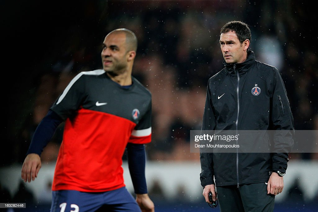 PSG coach Paul Clement takes warm up prior to the Round of 16 UEFA Champions League match between Paris St Germain and Valencia CF at Parc des Princes on March 6, 2013 in Paris, France.