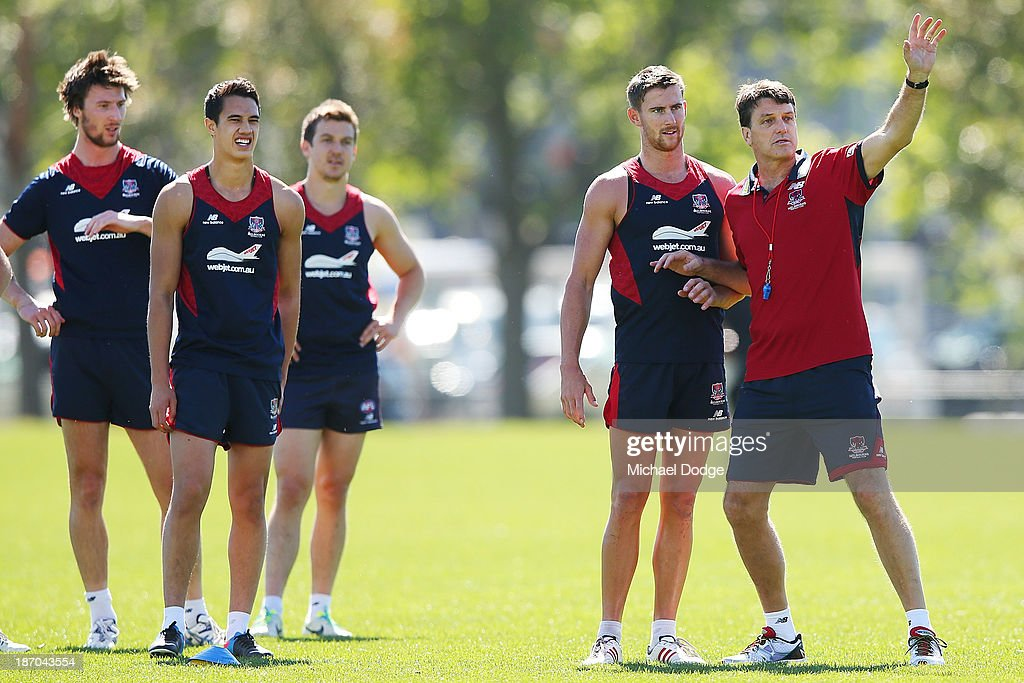 Coach <a gi-track='captionPersonalityLinkClicked' href=/galleries/search?phrase=Paul+Roos&family=editorial&specificpeople=193840 ng-click='$event.stopPropagation()'>Paul Roos</a> gestures to a player next to Jeremy Howe during a Melbourne Demons AFL training session at Gosch's Paddock on November 6, 2013 in Melbourne, Australia.