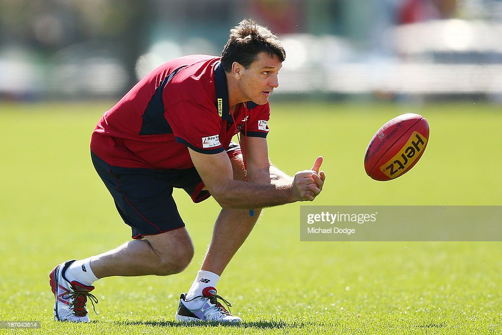 Coach <a gi-track='captionPersonalityLinkClicked' href=/galleries/search?phrase=Paul+Roos&family=editorial&specificpeople=193840 ng-click='$event.stopPropagation()'>Paul Roos</a> handpasses a ball during a Melbourne Demons AFL training session at Gosch's Paddock on November 6, 2013 in Melbourne, Australia.