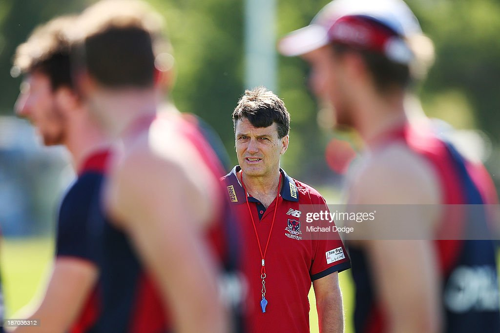 Coach <a gi-track='captionPersonalityLinkClicked' href=/galleries/search?phrase=Paul+Roos&family=editorial&specificpeople=193840 ng-click='$event.stopPropagation()'>Paul Roos</a> looks at the players during a Melbourne Demons AFL training session at Gosch's Paddock on November 6, 2013 in Melbourne, Australia.