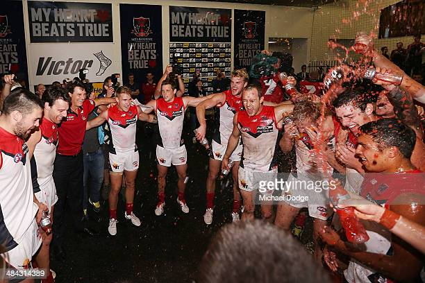 Coach Paul Roos of the Demons and players celebrate their win during the round four AFL match between the Carlton Blues and the Melbourne Demons at...