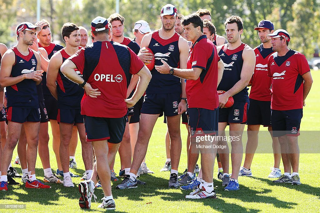 Coach <a gi-track='captionPersonalityLinkClicked' href=/galleries/search?phrase=Paul+Roos&family=editorial&specificpeople=193840 ng-click='$event.stopPropagation()'>Paul Roos</a> speaks to the team during a Melbourne Demons AFL training session at Gosch's Paddock on November 6, 2013 in Melbourne, Australia.